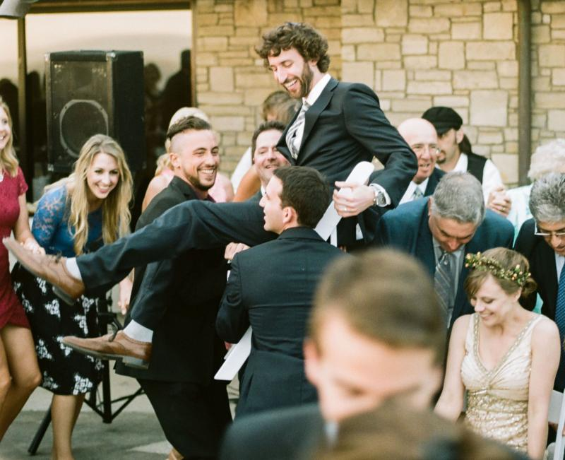 Chair Dance,Groom,Bride,lifting chairs,wedding,horah,live musicians,concert,folk